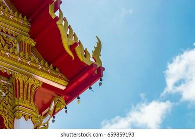Thai art on roof Church at Thai temple.