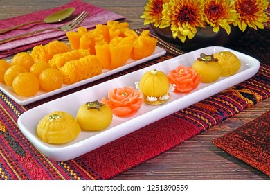 Thai auspicious food : Five mixed Thai Golden sweetmeat (Sa Ne Jan, DaraThong, Thong Chompoo Nuch, Thong Ek and Thong Nopphakhun), with three golden sweetmeats Famous Thai desserts for New year gift