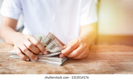 Thai baht bank note counting with woman hand.
