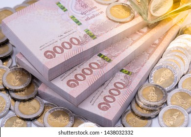 Thai baht banknotes and coins. Savings and investing concept