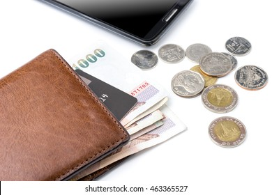 Thai baht money and credit card in brown wallet near smartphone and thai coins isolated on white background
