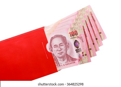 Thai bank note in red envelope for Chinese new year gift on white background
