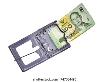 Thai banknote in mouse trap on white background. business concept.