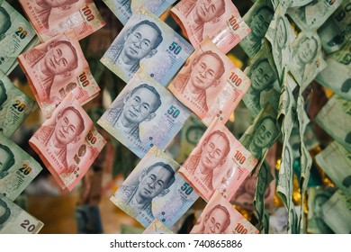 Thai Banknotes Close up, Hanged on Money Tree as Buddhist Offerings at Southeast Asia Temple, consisted of 20 baht, 50 baht, and 100 baht notes.