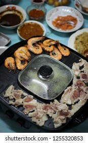 Thai barbecue buffet pig pan with family.