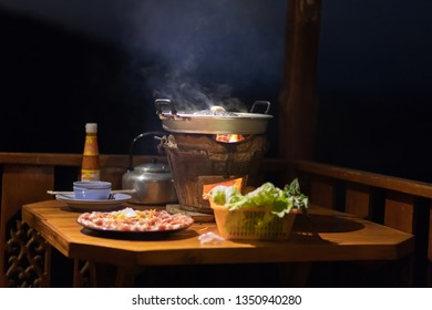 Thai barbecue Grill Pork on hot pan buffet. It's traditional Thai style BBQ, barbecue buffet pig pan and vegetables in soup. Moo Kra Ta (thai word)
