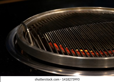 Thai barbecue Grill Pork on hot pan buffet, Moo-gata Pork pan It's traditional Thai style BBQ