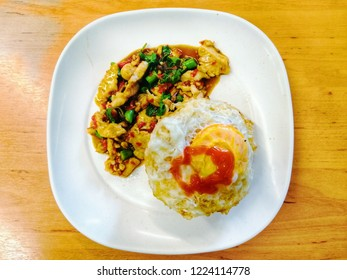 """Thai basil chicken  recipe and egg souse on wood background  """"pad kra pao gai""""  Thailand Recipes concept."""