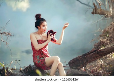 Thai beautiful countryside woman bathing in the river that flowing through the village.Relax and cleaning of young sweets thai woman in waterfall.