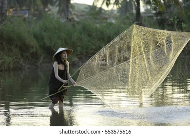 Thai Beauty Young girls fishing in the river.