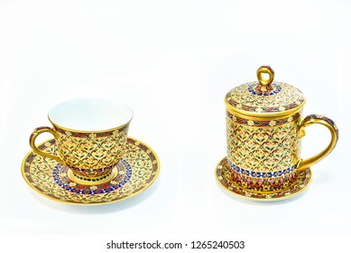 Thai Benjarong porcelain set consists of mug and cup of tea, isolated on white background.
