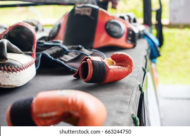 Thai Boxing Gear Mitt Pad Punch Glove Training on Canvas Ring in Gym or Camp Selective Focus
