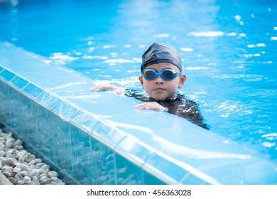 Thai boy is swimming in pool