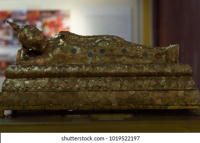 Thai buddah sleep style with coin