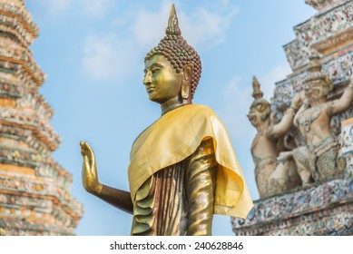 Thai Buddha a stupa, Golden sculpture, Wat Arun temple in Bangkok, Thailand.