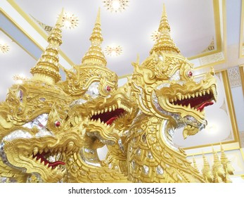 Thai carving great naga in beautiful gold color.