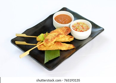 Thai chicken Satay or marinated chicken with peanut sauce, isolated on white background, studio shooting/setup.