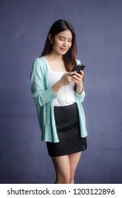 thai china adult office girl white shirt using her smart phone