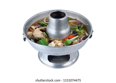 Thai clear spicy hot & sour soup (Tomyum) with boiled asian red tail cat fish fillet and herb usually served in a metal pot heated by a charcoal fire