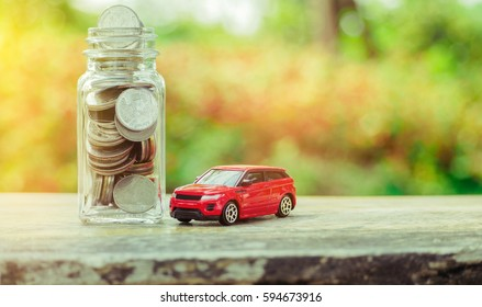 Thai coin money and car model on wood for finance and banking concept.