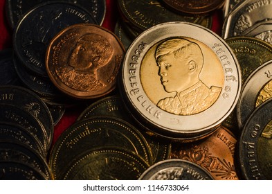thai coin pile on dark background,selective focus.