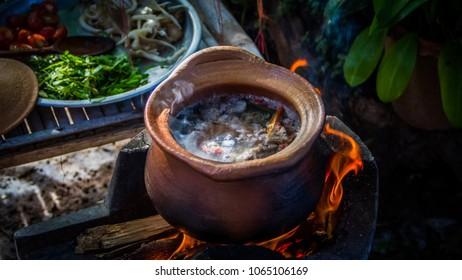 Thai cooking in earthen pot.