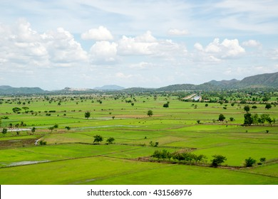 Thai countryside with multiple rice paddies, in horizontal orientation. Kanchanaburi, Thailand.