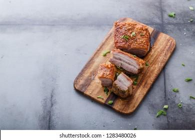 Thai crispy skin pork belly on wooden board, copy space.