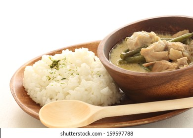 Thai cuisine, chicken and bean green curry served with steamed rice