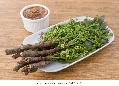 Thai Cuisine and Food, Dish of Margosa or Neem Leaves and Blossom Served with Sweet Sauce.