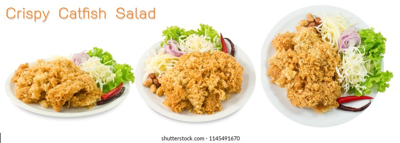 Thai Cuisine and Food, Thai Traditional Crispy Catfish Salad Served With Green Oaks, Shredded Green Mangoes, Red Onions, Cabbage, Chilies and Peanuts Isolated on White Background.