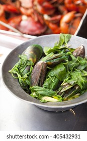 Thai Cuisine - Mussels steamed with herbs and thai basil , lemon grass - seafood at Yaowarat Chinatown (in Bangkok)