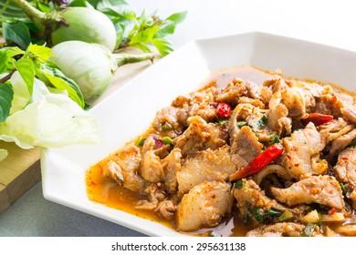 Thai cuisine spicy pork salad, Moo Nam Tok with vegetable, Thai food.