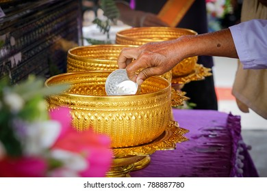 Thai culture of Funeral,close up of woman hand scoop water by golden bowl