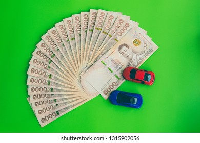 Thai Currency 1000 Baht,Thai money banknote one thousand thai baht and car on green background. Business and financial concept