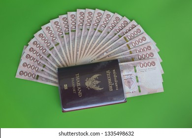 Thai Currency 1000 Baht,Thai money banknote one thousand thai baht and Thailand pasport on green background. Business and financial concept