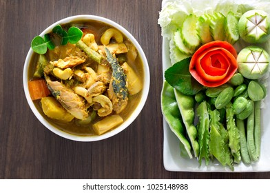 Thai curry fish paunch sour soup (Kang Tai Pla) spicy delicious mix with herb , popular Thai food with vegetable for eat