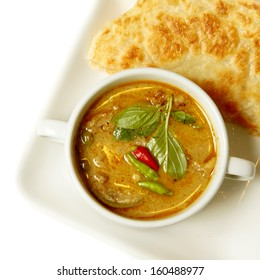 Thai curry food and Southern flat bread.