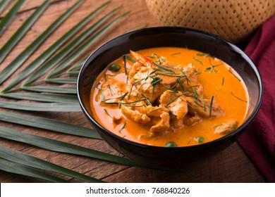 Thai curry red soup,Thailand tradition red curry with beef,pork or chicken menu in thai name is panaeng.Curry menu with coconut milk.Panaeng Curry on Wooden table