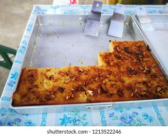 Thai custard cake baked and sprinkled with deep fried red onions , Khanom Moa Gang (Thai Custard Cake)