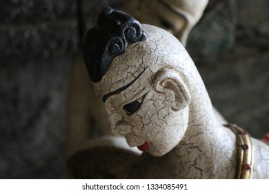 Thai dancer figurine with distress finish