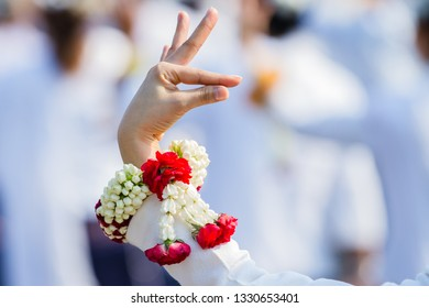 Thai dancing with beautiful flower garlands in hand.