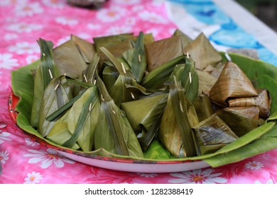 Thai Dessert is called Kanom Sai Sai; Coconut meat with coconut milk. It's wrapped in banana leaves.