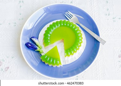 Thai dessert or Thai food style. green pandan and coconut milk jelly sweet dessert with slice and  butterfly pea.Selective focus