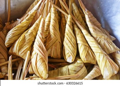 Thai dessert, Khanom Tom, steamed sticky rice wrapped fan palm leaf use for religious ceremony in southern of Thailand