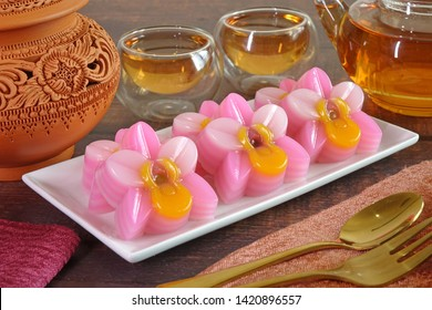 Thai dessert : Layer sweet cake (or Khanom Chan) Thai traditional dessert in pink orchid flowers shaped. One of nine famous Thai auspicious desserts in Thailand.