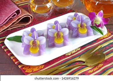 Thai dessert : Layer sweet cake (or Khanom Chan) Thai traditional dessert in colorful orchid flowers shaped. One of nine famous Thai auspicious desserts in Thailand.