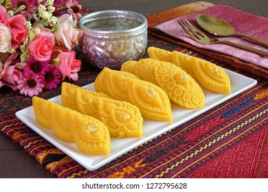 Thai dessert (Royal Thai cuisine) : Golden sweetmeat  (Kha nom Thong Ek) , one of famous nine auspicious desserts in Thai tradition, made from yolk, wheat flour and edible gold. Copy space