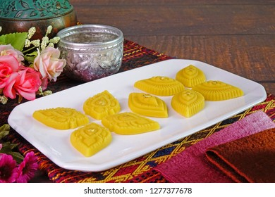 Thai dessert / Royal Thai cuisine : Golden sweetmeat  (Kha nom Thong Ek) , one of famous nine auspicious desserts in Thai tradition, made from yolk, wheat flour and edible gold. Copy space