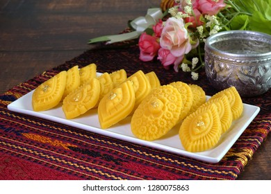 Thai dessert / Royal Thai cuisine : Golden sweetmeat  (Kha nom Thong Ek) , one of famous nine auspicious desserts in Thai tradition, made from yolk, wheat flour and edible gold. Space for texts.